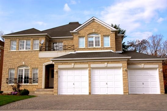 New detached single family luxury home with stone facade and tripple garage